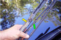 Separate the blade (green arrow) from the wiper arm (yellow arrow) and continue to hold on to the wiper arm.