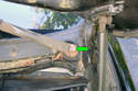 Remove the 16mm fastener (green arrow) that mounts the left side wiper arm to the shaft.