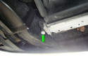 This photo illustrates underneath the car on the left side of the bottom of the radiator.