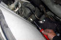On the older model E39 use a flat head screwdriver to remove the loosen radiator hose clamp.