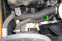 With the air intake duct and resonance chamber removed you can see the lower radiator hose (green arrow) which connects the radiator with the thermostat.
