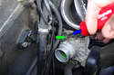You can use a flat head screwdriver to push the thermostat electrical connector retaining clip (green arrow) in the direction of the blue arrow.