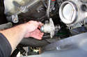 The thermostat will probably be held in place in the water pump.