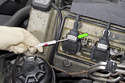 Using a small flathead screwdriver; release ignition coil electrical connector retainer by prying up, then pull electrical connector straight out of ignition coil.