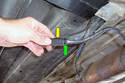 Separate each oxygen sensor connector by squeezing the end of the connector (green arrow) and the other side the connector (yellow arrow) and pulling then straight apart.