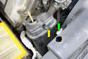 Remove the small hose from the nipple on the expansion tank (yellow arrow).