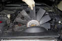 If you are only replacing the viscous cooling fan, you can now lift the shroud enough to slide it out.