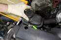 Lift the coolant expansion tank out of the shroud.