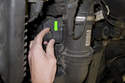 Disconnect the mass airflow sensor electrical connector by rotating electrical connector (green arrow) counterclockwise and pulling it straight off.