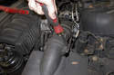 Then unclip the two spring clips that hold the mass air flow sensor into the air filter housing lid.