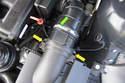 Next, using a flathead screwdriver, loosen the mass airflow sensor clamp (green arrow).
