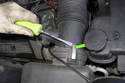 Using a flathead screwdriver, unclip the top spring clip (green arrow) that holds the mass airflow sensor into the air filter housing lid.