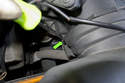 Using a flathead screwdriver, unclip the lower spring clip (green arrow) that holds the mass airflow sensor into the air filter housing lid.