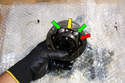 Flip over the CV joint and install the remaining ball bearings (green arrows).