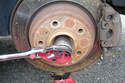 With a 36mm, 12 point socket remove the axle nut in the counter clockwise direction.