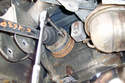 This photo illustrates under the car on the left side looking at the inner axle shaft mounting to the differential.