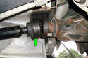 Carefully separate the CV joint on the driveshaft from the differential input flange.