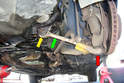This is the front lower control arm (green arrow) that we are going to remove.