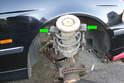 Using coil spring compressors compress the strut spring.