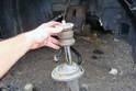 Remove the bump stop on the strut shaft.