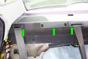 Use a plastic prying tool to lever off the plastic covers (green arrows) at their lower edge on the right side of the car.