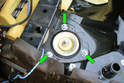 Remove the three 13mm mounting nuts (green arrows) that mount the upper strut to the body of the car.