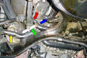 Working at the right side radius arm sub-frame mount remove the mounting bolt (green arrow) by pulling it in the direction of the blue arrow.