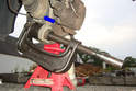 Use a ball-joint press to press out the lower ball-joint in the direction of the blue arrow.