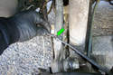 Remove the ABS wheel speed sensor wiring from its clip on the rear rearward upper link.