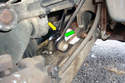 This photo illustrates the left side swaybar link where it attaches to the lower control arm.