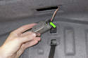 Lever out the trunk light lens using a flathead screwdriver.