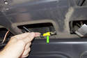 Working on the right side of the trunk lid, locate the trunk release button electrical connector (green arrow).
