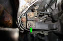 Remove the 13mm fastener (green arrow) that holds the battery cable to the starter solenoid.