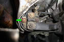 Remove the 10mm fastener (green arrow) that holds the starter signal to the solenoid.