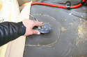 Remove the rubber grommet from the inspection cover and move both pieces out of the way.