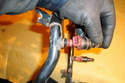 Twist the injector while pulling it out of the fuel rail to remove it.