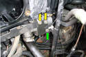 Locate the oil dipstick tube and move down the tube until you see its mount on the intake bracket.