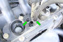 Remove the two small hoses (green arrows) under the intake manifold by the throttle body.