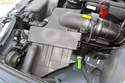 Remove the air filter housing assembly.