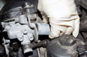 Remove the VANOS solenoid from cylinder head, be ready to any catch dripping oil in a rag.