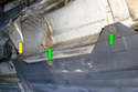 Working underneath the car at the inner part of the lower panel remove the two 8mm screws (green arrows) and the one 10mm fasteners (yellow arrow) towards the back of the panel.