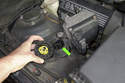 If you are using a BMW scan tool or a Peake code reader, you can connect to the 20 pin connector (green arrow) on the right side of the engine compartment.