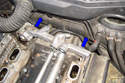 With all the fasteners removed remove the rear cooling manifold by moving it in the direction of the blue arrows.