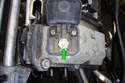8-Cylinder Engine - This photo illustrates the front of the left side valve cover, on top remove the 19mm fastener (green arrow) that holds the positive jumper terminal to the valve cover.