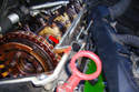 8-Cylinder Engine - Also clean the right side valve cover gasket surface (red arrow) on the cylinder head to prepare for installation.