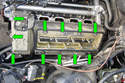 If you chose to give yourself more room to work, remove the engine coil cover, coils and valve cover fasteners (green arrows) of the exhaust manifold you are trying to replace.