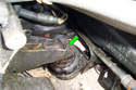 If you are doing the left side exhaust manifolds remove the left side motor mount upper mounting bolt (green arrow) isPictured.