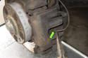 Pull brake pad wear sensor (green arrow) out of brake pad out of left side brake pad.