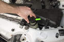 When pressure testing a cooling system, be sure the vehicle is cool and lacks pressure before removing the coolant expansion tank cap.