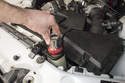 Once the cap is removed, install pressure tester adapter to the coolant expansion tank.